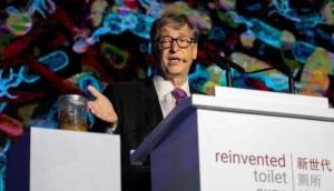Bill Gates backs China's toilet revolution with poops in hand at an event to raise awareness