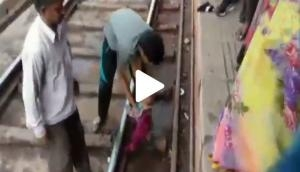 Mathura: Miracle! One-year-old girl survived unhurt after a train passed over her; here's the shocking video