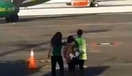 Viral Video: OMG! Woman missed her flight, tries to chase down moving plane