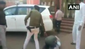 Watch: Farmer in Madhya Pradesh's Shivpuri cries, falls down on the feet of District Collector to fulfill his demand