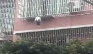 Scary Video: Girl trapped between railings by neck, dangles from third floor balcony and....!