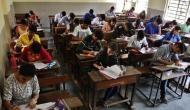 UP Board Exam: मऊ में सामाजिक विज्ञान का पेपर लीक, परीक्षा केंद्र के बाहर लिखी जा रही थीं कॉपियां