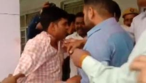 Watch: BJP workers beat up poll officer in Moradabad as he allegedly asked voters to press 'cycle' button
