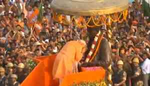 Modi chants echo in Varanasi as Prime Minister's road show turns city into 'saffron tsunami'