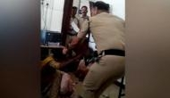 Madhya Pradesh: Cop caught on camera ruthlessly thrashing woman with child in Gwalior police station