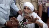 Delhi Polls: 111 year old Bachan Singh, oldest voter in Delhi casts vote