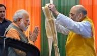 Amit Shah congratulates PM Modi on entering 20th year of public service