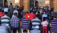 Watch how little girl in Kashmir climbs on to dad's back while praying in the mosque; see the cutest video