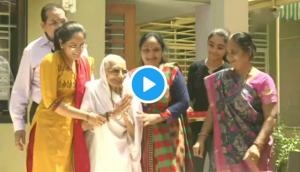 Watch how PM Modi's mother greets BJP's supporters outside her house; see video