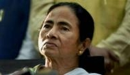 Mamata Banerjee says BJP luring her workers with crores, Dilip Ghosh says TMC members don't lack money