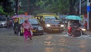 Heavy rain in Mumbai after dry spell; trains, road traffic hit
