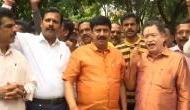 Karnataka: BJP workers celebrate outside Yeddyurappa's residence