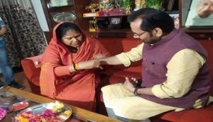 Sadhvi Niranjan Jyoti ties rakhi to Mukhtar Abbas Naqvi