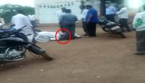 Telangana: Two farmers seen touching feet of Revenue officer requesting to settle land issue