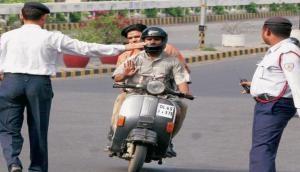 Kerala: Man riding two-wheeler injured after cop throws lathi at him during vehicle checking