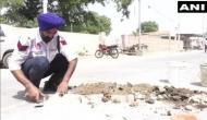Punjab: Meet traffic cop who fills up potholes on Bhatinda roads