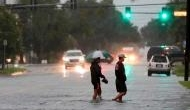 China: 2 dead as Imelda strands drivers, floods homes in Texas