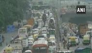 Delhi: Slow traffic movement in Anand Vihar due to farmers protest at NH-24