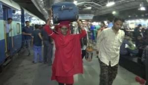 At Bhopal's railway station meet Lakshmi, the woman coolie