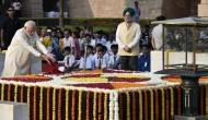 PM Modi pays homage to Mahatma Gandhi at Rajghat on his 150th birth anniversary