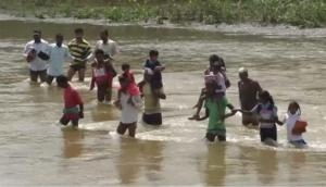 Chhattisgarh: Students risk lives while crossing river to reach school, rainwater adds to woes