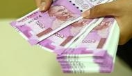 Rupee falls 2 paise against US dollar in early trade