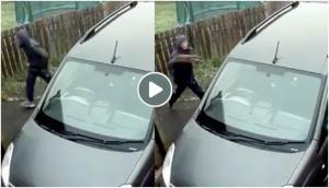 Thief tries to break car glass via brick, hit himself instead; video will teach you how karma pays back!