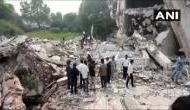 Building implodes in Gujarat's Vadodara, many feared trapped