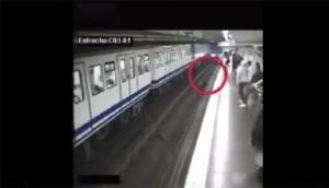 Watch: Woman on phone falls in front of approaching train in scary footage