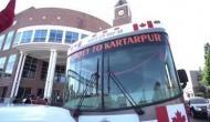 Sikh pilgrims reach Gurdwara Punja Sahib from Canada in a bus for Kartarpur Corridor opening