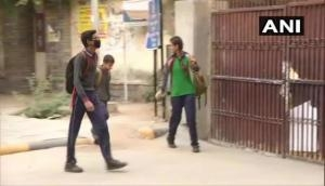 Delhi: Schools reopen after extended Diwali break due to pollution, students wear anti-pollution masks