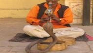 UP cop plays flute to capture snake spotted in police station; video goes viral