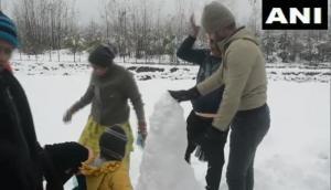 J-K: Tourists enjoy snowfall in Pahalgam