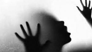 Professor allegedly rapes woman after 'spiking' her drink