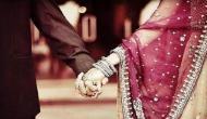 अयोध्या: मुस्लिम परिवार ने पेश की अनोखी मिसाल, शादी के कार्ड में छपवाई हिंदू देवताओं की तस्वीर
