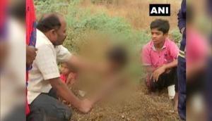 सूर्य ग्रहण के दौरान दिव्यांग बच्चों को गले तक जमीन में दफनाया