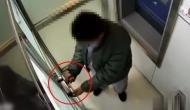 ATM को लूटने पहुंचा था ये चोर, वीडियो में देखें कैसे हुआ दरवाजे में कैद