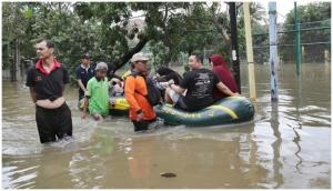 Indonesia Flood: Rescuers hunt for missing after 43 killed