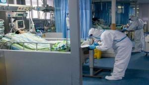 चीन में कोरोना वायरस से 132 लोगों की मौत, Apple ने बंद किया स्टोर, रोकी यात्रा