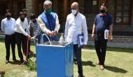 Coronavirus: Uttarakhand scientist gives demo of handwashing machine to CM Trivendra Singh Rawat
