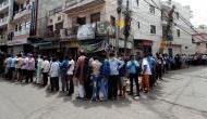 Delhi: Long queues, crowds continue at liquor shops despite tax hike