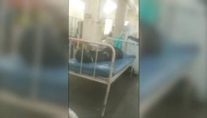 Mumbai: Shocking video shows coronavirus patients in hospital ward lying next to corpses wrapped in body bags [Watch]