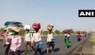 Lockdown: Braving scorching heat, migrant workers walk down to their homes