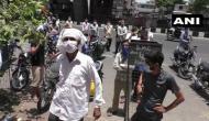 Gujarat: Amid lockdown 4 buyers throng tobacco shops in Surat