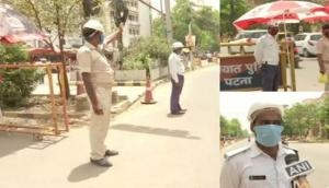 Amid scorching heat Bihar cops perform duties; urge people to stay indoors