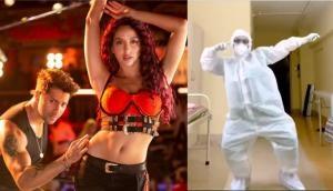 Watch doctor in PPE kit performs dance on Varun Dhawan-Nora Fatehi's Garmi song