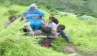 Uttarakhand: Locals carry patient on makeshift stretcher as roads remain blocked due to landslide