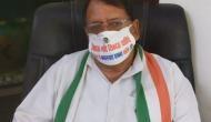 MP: Congress leaders adorn masks seeking 'return of Kamal Nath govt'