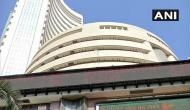 Equity indices close flat after volatile session, metal stocks gain
