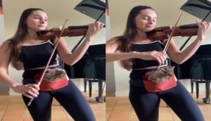 Viral Video: महिला ने ऐसे बजाया वायलिन कि बिल्ली भी हो गई खुश, वीडियो में देखें कैसे दिया कैट ने रिएक्शन